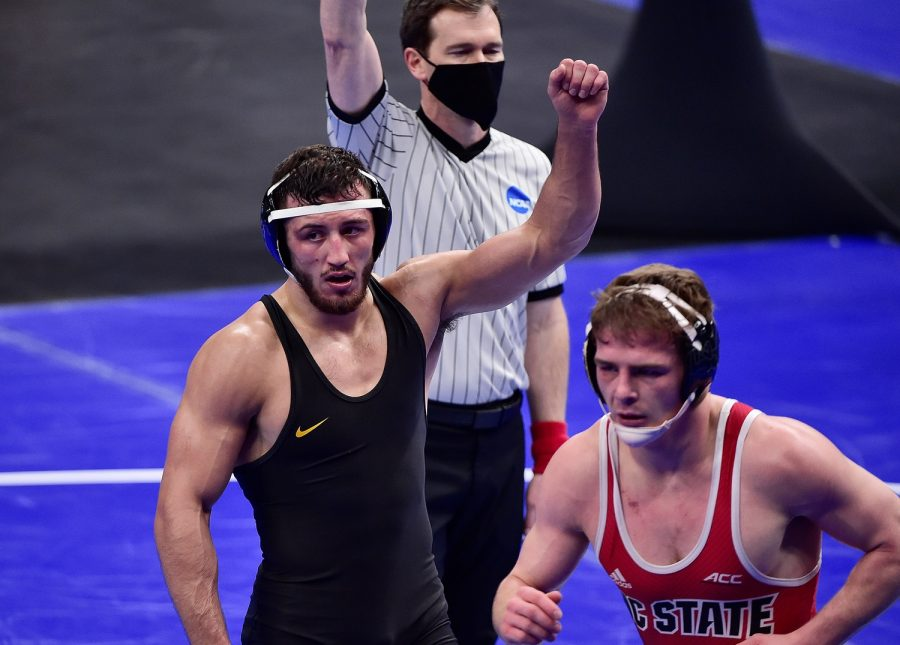 Mar 19, 2021; St. Louis, Missouri, USA;  Iowa Hawkeyes wrestler Michael Kemerer celebrates after defeating North Carolina State Wolfpack wrestler Daniel Bullard in the 174 weight class during the quarterfinals of the NCAA Division I Wrestling Championships at Enterprise Center. Mandatory Credit: Jeff Curry-USA TODAY Sports