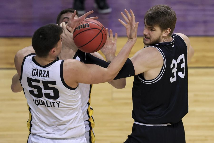 Mar 20, 2021; Indianapolis, IN, USA; Iowa Hawkeyes center Luka Garza (55) and Grand Canyon Antelopes center Asbj rn Midtgaard (33) fight for the ball during the first round of the 2021 NCAA Tournament at Indiana Farmers Coliseum. Mandatory Credit: Aaron Doster-USA TODAY Sports