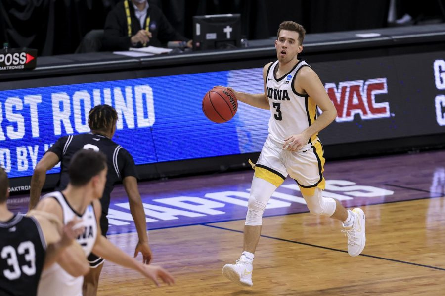 Mar 20, 2021; Indianapolis, IN, USA; Iowa Hawkeyes guard Jordan Bohannon (3) brings the ball up court against the Grand Canyon Antelopes during the first round of the 2021 NCAA Tournament at Indiana Farmers Coliseum. Mandatory Credit: Aaron Doster-USA TODAY Sports