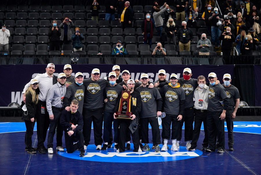 Mar 20, 2021; St. Louis, Missouri, USA;  Iowa Hawkeyes wrestling team pose for a photo after winning the NCAA Division I Wrestling Championships at Enterprise Center. Mandatory Credit: Jeff Curry-USA TODAY Sports