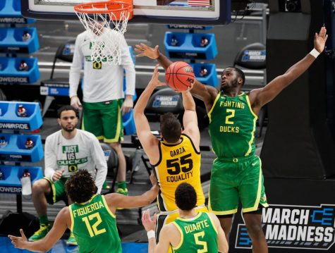 Oregon Ducks forward Eugene Omoruyi (2) blocks the shot attempt by Iowa Hawkeyes center Luka Garza (55) during the second round of the 2021 NCAA Tournament on Monday, March 22, 2021, at Bankers Life Fieldhouse in Indianapolis, Ind. Mandatory Credit: Barbara Perenic/IndyStar via USA TODAY Sports