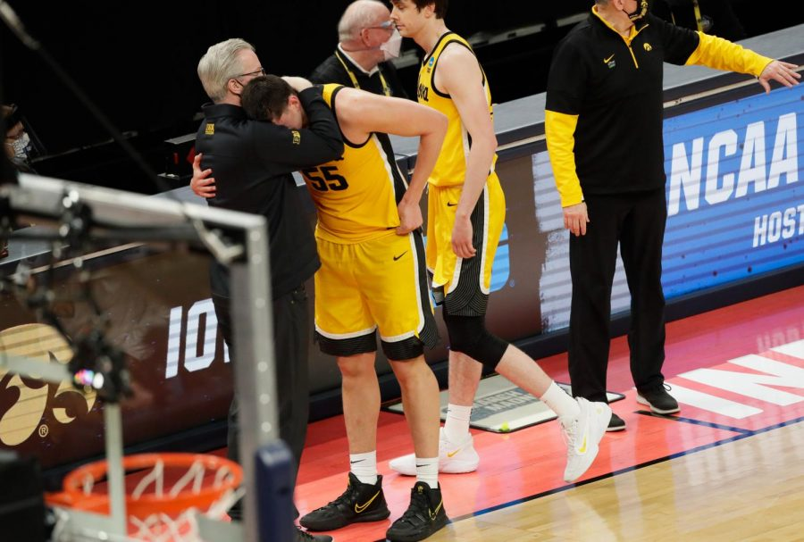 Iowa Hawkeyes center Luka Garza (55) hugs Iowa Hawkeyes head coach Fran McCaffery after their 95-80 loss against the Oregon Ducks during the second round of the 2021 NCAA Tournament on Monday, March 22, 2021, at Bankers Life Fieldhouse in Indianapolis, Ind. Mandatory Credit: Barbara Perenic/IndyStar via USA TODAY Sports