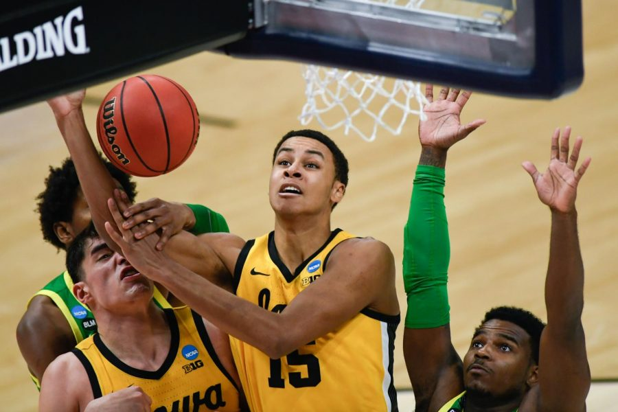 Oregon Ducks forward Chandler Lawson (13) pushes Iowa Hawkeyes forward Keegan Murray's (15) hand into guard Joe Wieskamp's (10) face as he blocks Murray from making the shot during the second round of the 2021 NCAA Tournament on Monday, March 22, 2021, at Bankers Life Fieldhouse in Indianapolis, Ind. Mandatory Credit: Sam Owens/IndyStar via USA TODAY Sports