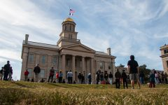 The Old Capital in Iowa City is seen during a vigil on Sunday, March 21 to honor the victims of the Atlanta shootings and advocate for Asian American rights and equity.