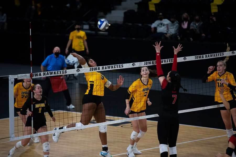 Iowa Middle Blocker Amiya Jones prepares to spike the ball during a women's volleyball match between Iowa and Rutgers at Xtream Arena on Saturday, Feb. 20, 2021. The Scarlet Knights defeated the Hawkeyes 3 sets to 2.