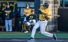 Iowa outfielder Trenton Wallace swings while at-bat during the second game of a baseball doubleheader between Iowa and Cal-State Northridge at Duane Banks Field on Sunday, March 17, 2019.