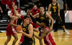 Iowa forward Luka Garza looks to pass during a men's basketball game between Iowa and Wisconsin at Carver-Hawkeye Arena on Sunday, March 7, 2021. The Hawkeyes, celebrating senior day, defeated the Badgers, 77-73.