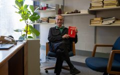 """Professor Patrick Schlievert displays his new book """"What Was I Thinking?"""" on Monday, March 1, 2021. Schlievert said he wants to make his research known to the people. """"The American public to me is who I do my research for. Period, he said."""