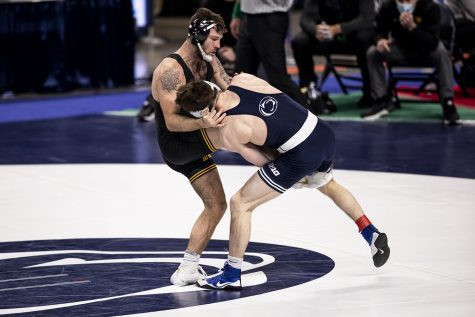 Iowa's Jaydin Eierman defends against a single leg from Penn State's Nick Lee during the finals of the Big Ten Wrestling Tournament at the Bryce Jordan Center in State College, PA on Sunday, March 8, 2021. Eierman won the match by decision 6-5. Ryan Adams/The Daily Iowan)