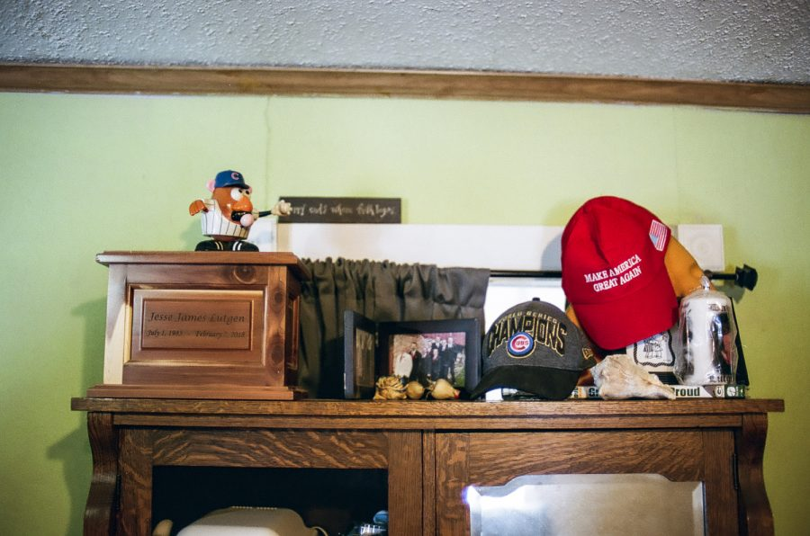 Jesse Luntgens ashes sit in an urn on a shelf in the home of his mother Janelle alongside photographs and other items including a Chicago Cubs world series has and a Make America Great Again hat the home of his mother Janelle.  Janelle Luntgen serves as the chair of the Republican party chair in Jackson county and says she believes that insulin prices are not a partisan issue.