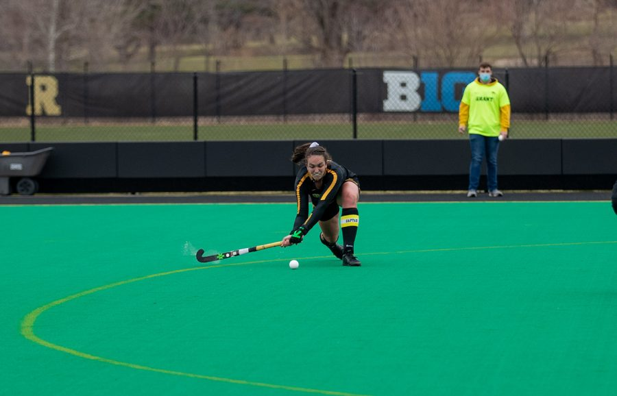 Iowa Defender Anthe Ninjziel slaps the ball to a teammate during a field hockey game between Iowa and Michigan at Grant Field on Friday, March 12, 2021. The Wolverines beat the Hawkeyes 1-0.
