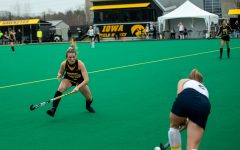 Iowa Forward Maddy Murphy attempts to block a pass from Michigan's Clare Brush during a field hockey game between Iowa and Michigan at Grant Field on Friday, March 12, 2021. The Wolverines beat the Hawkeyes 1-0.