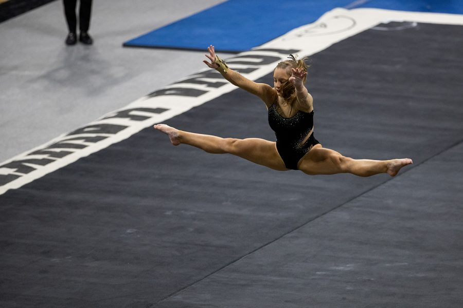 Iowa%E2%80%99s+Lauren+Guerin+is+seen+doing+a+jump+during+her+floor+routine+at+a+women%E2%80%99s+gymnastics+meet+between+the+Iowa+Gym-Hawks+and+the+Minnesota+Golden+Gophers+at+Carver-Hawkeye+Arena+on+Saturday%2C+Feb.+6%2C+2021.+The+Hawks+defeated+the+Gophers%2C+196.800-196.375.