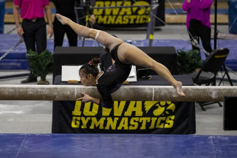 Iowas all-around Adeline Kenlin performs on the beam during a gymnastics meet against Ohio State on Saturday, Jan. 23, 2021 at Carver Hawkeye arena. The Hawkeyes defeated the Buckeyes with a score, 196.550-193.800. Kenlin earned a score of 9.825.