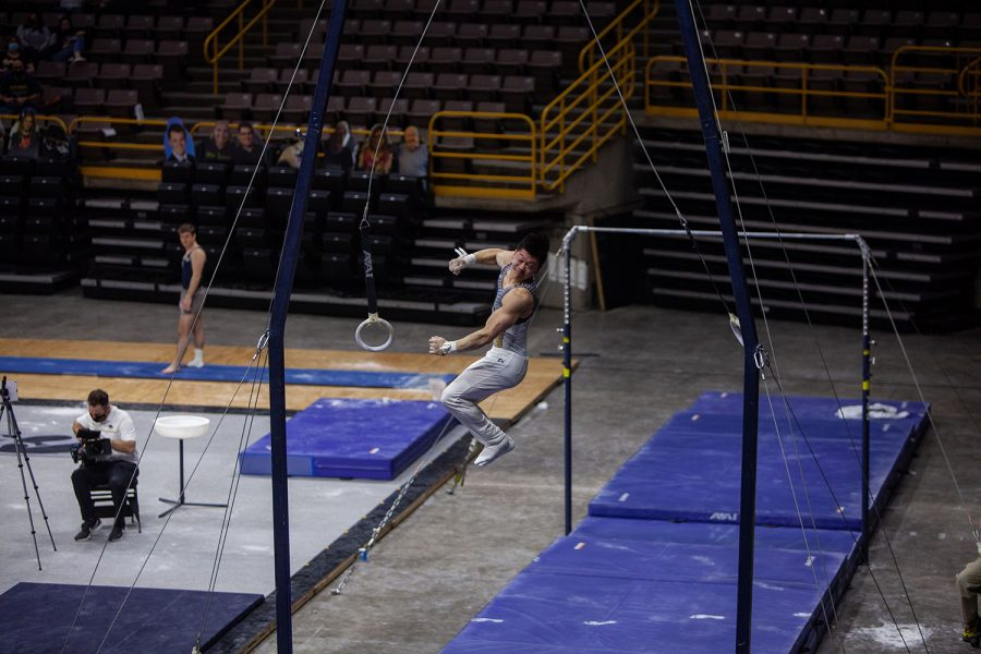 Iowa all around Bennet Huang performs on the rings on Saturday, Feb. 20, 2022 during the Iowa vs. Penn State men's gymnastics meet at Carver-Hawkeye Arena. Iowa defeated Penn State 398.850-393.550. Huang placed seventh overall on the rings with a final score of 12.700.
