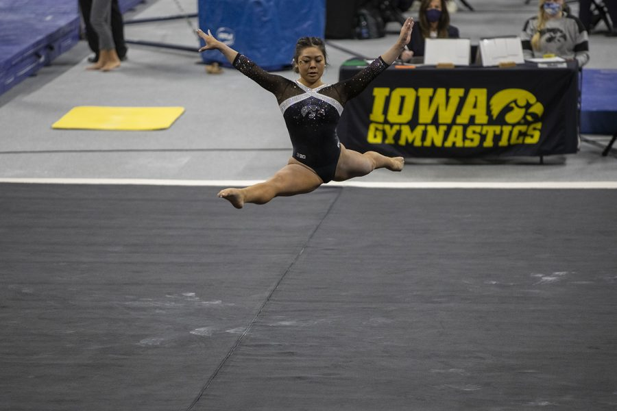 Iowa's Clair Kaji performs her floor routine during a women's gymnastics meet between Iowa, Minnesota, and Maryland on Saturday, Feb. 13, 2021 at Carver Hawkeye Arena. The Hawkeyes came in second with a score of 196.775 after the Gophers won with 196.975 and Maryland lost with 195.350. Kaji received a score of 9.900.