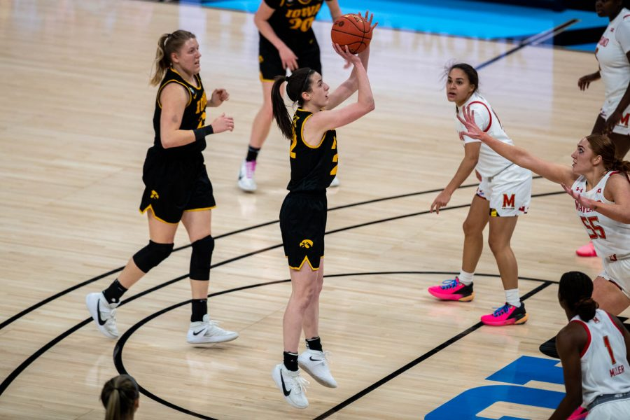 Iowa Guard Caitlin Clark (22) shoots the ball during the first half of the championship game of the Big Ten women's basketball tournament. Iowa, ranked No. 6, took on No. 1 seeded Maryland in Indianapolis at the Bankers Life Fieldhouse Saturday afternoon.