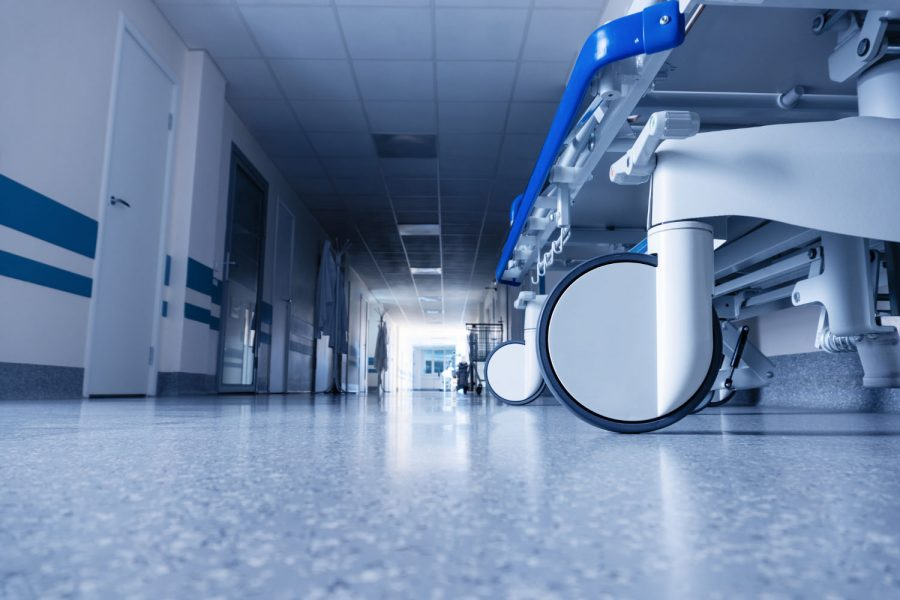 Medical bed on wheels in the hospital corridor.