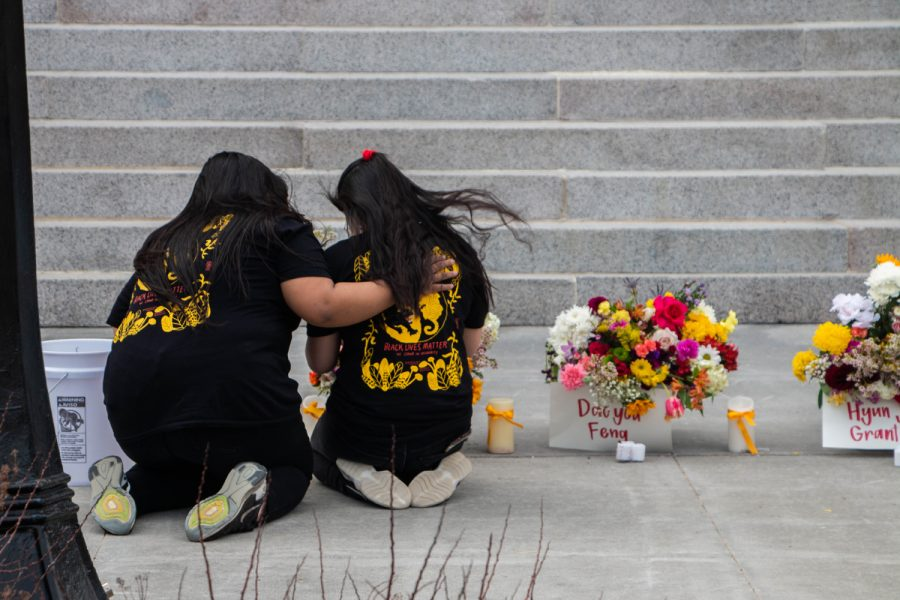 Two students comfort each other during a vigil on Sunday, March 21 to honor the victims of the Atlanta shootings and advocate for Asian-American rights and equality.