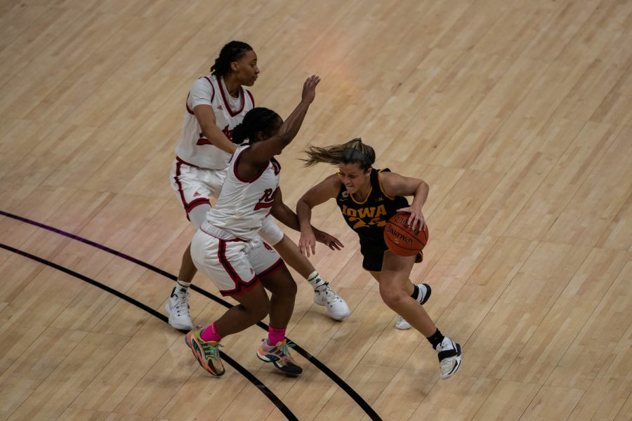 Iowa Guard Gabbie Marshall (24) charges towards the basket during a quarterfinal game of the Big 10 women's basketball tournament. Iowa, ranked No. 6, took on No. 3 seeded Rutgers in Indianapolis at the Bankers Life Fieldhouse Thursday night. (Kate Heston/The Daily iowan