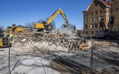 Construction equipment  began the removal of the original U of I hospital, on Tuesday, Dec.1, 2020. The hospital became Seashore hall in 1929.A worker sprays down the rubble that was once the hall, to help control dust..