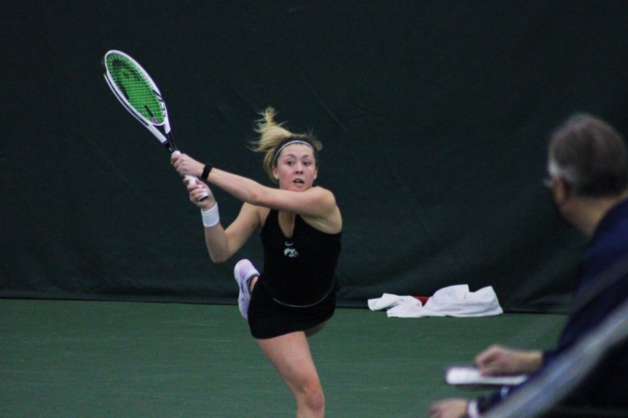 Iowa freshman Alexa Noel swings at a ball during her singles match at the Iowa women's tennis meet v. Ohio State on Sunday, March 7, 2021. While Noel won her match 6-2, the Hawkeyes were defeated by the Buckeyes, 2-5.