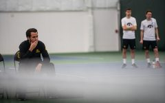 Iowa head coach Ross Wilson watches his team play during a men's tennis match between Iowa and Nebraska-Omaha at the HTRC on Saturday, Jan. 25, 2020. The Hawkeyes defeated the Mavericks, 6-1.
