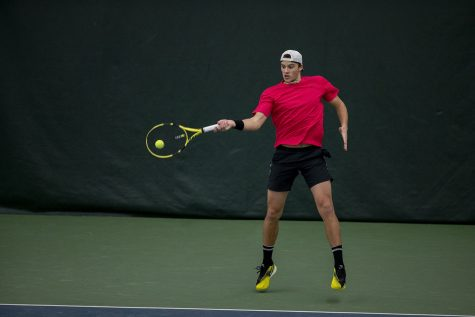 Iowa's Joe Tyler hits the ball at the Iowa Men's tennis meet v. Indiana in the Hawkeye Tennis and Recreation Complex on Friday, Feb. 19, 2021. Iowa defeated Indiana with a score of 5-2.