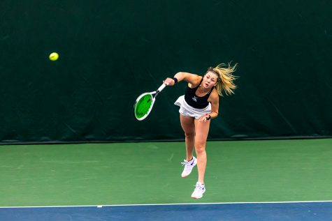Iowa's Alexa Noel serves the ball during the Iowa Women's Tennis match against Purdue on Feb. 28, 2021 at the Hawkeye Tennis and Recreation Complex. Iowa defeated Purdue 6-1.