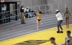 Iowa mid distance runner Mallory King pushes down the home stretch in the 800m run premier during the second day of the Larry Wieczorek Invitational on Saturday, Jan. 23, 2021 at the University of Iowa Recreation Building. King won the race with a time of 2:06.00. Due to coronavirus restrictions, the Hawkeyes could only host Big Ten teams. Iowa men took first, scoring 189, and women finished third with 104 among Minnesota, Wisconsin, Nebraska, and Illinois.