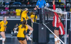 Iowa Middle Blocker Hannah Clayton hits the ball over the net during the Iowa Volleyball game against Indiana on Feb. 6, 2021 at Xtream Arena. Indiana defeated Iowa 3-2.