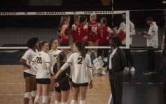 Iowa head coach Vicki Brown talks to players from the sidelines during the Iowa vs Rutgers match at Xtream Arena on Feb. 19, 2021. Iowa defeated Rutgers, 3-1.