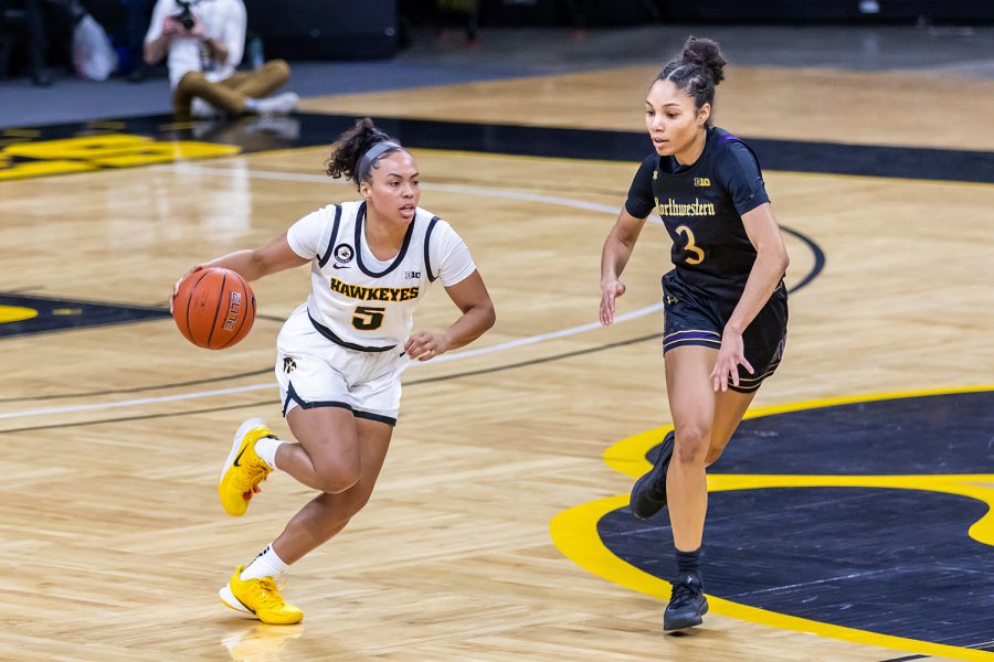 Iowa Guard Alexis Sevillian dribbles the ball down the court during the Iowa Women's Basketball game against Northwestern on Jan. 28, 2021 at Carver-Hawkeye Arena. Northwestern defeated Iowa 87-80