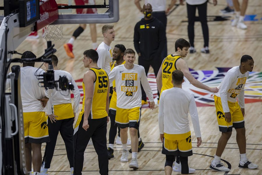 Iowa players warm up before the Big Ten men's basketball tournament quarterfinals against Wisconsin on Friday, March 12, 2021 at Lucas Oil Stadium in Indianapolis.