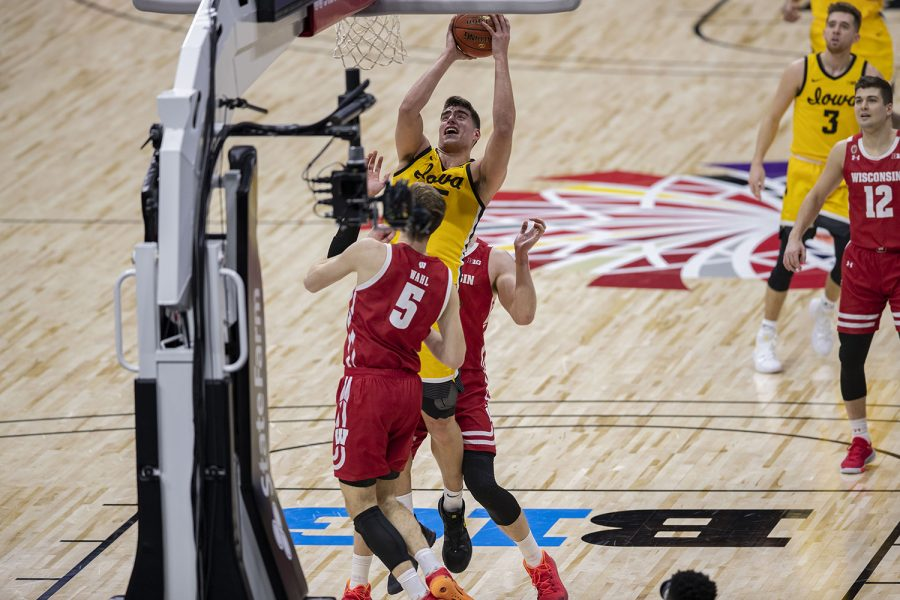 Iowa center Luka Garza attempts to shoot a basket during the first half of the Big Ten men's basketball tournament quarterfinals against Wisconsin on Friday, March 12, 2021 at Lucas Oil Stadium in Indianapolis. The Hawkeyes are behind the Badgers, 26-32 at halftime.