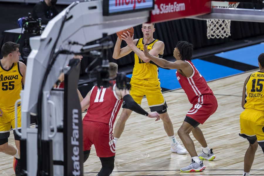 Iowa guard Joe Wieskamp looks to pass the ball during the first half of the Big Ten men's basketball tournament quarterfinals against Wisconsin on Friday, March 12, 2021 at Lucas Oil Stadium in Indianapolis. The Hawkeyes are behind the Badgers, 26-32 at halftime.