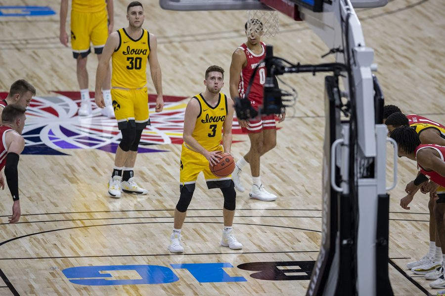 Iowa guard Jordan Bohannon prepares to shoot a free throw during the Big Ten men's basketball tournament quarterfinals against Wisconsin on Friday, March 12, 2021 at Lucas Oil Stadium in Indianapolis. The Hawkeyes defeated the Badgers, 62-57. No. 3 Iowa will go on to play No. 2 Illinois tomorrow afternoon in the semifinals.