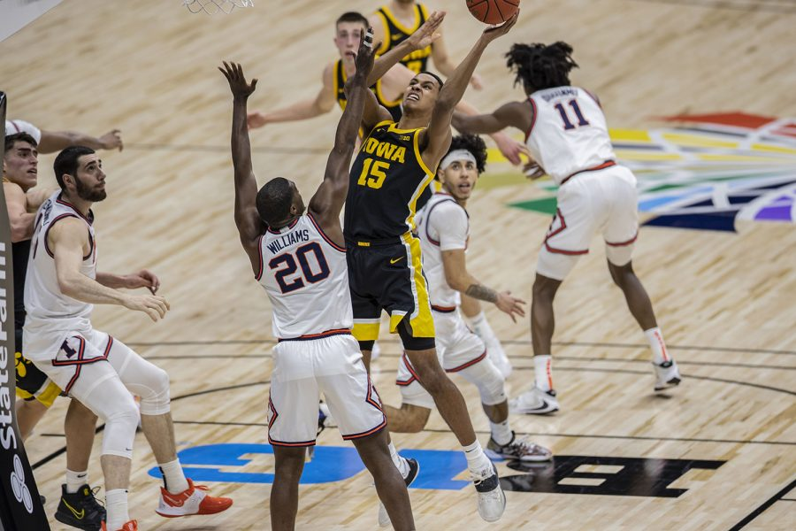 Iowa forward Keegan Murray attempts to shoot a basket during the Big Ten men's basketball tournament semifinals against Illinois on Saturday, March 13, 2021 at Lucas Oil Stadium in Indianapolis. The Hawkeyes were defeated by the Fighting Illini, 82-71. No. 2 Illinois and No. 5 Ohio State will compete in the championship game tomorrow afternoon.