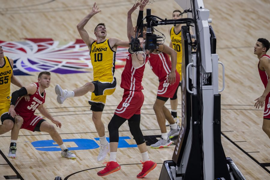 Iowa guard Joe Wieskamp attempts to shoot a basket during the Big Ten men's basketball tournament quarterfinals against Wisconsin on Friday, March 12, 2021 at Lucas Oil Stadium in Indianapolis. The Hawkeyes defeated the Badgers, 62-57. No. 3 Iowa will go on to play No. 2 Illinois tomorrow afternoon in the semifinals.