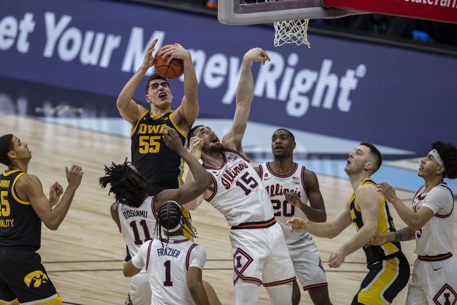 Iowa center Luka Garza catches a rebound and then drops it during the Big Ten men's basketball tournament semifinals against Illinois on Saturday, March 13, 2021 at Lucas Oil Stadium in Indianapolis. The Hawkeyes were defeated by the Fighting Illini, 82-71. No. 2 Illinois and No. 5 Ohio State will compete in the championship game tomorrow afternoon.
