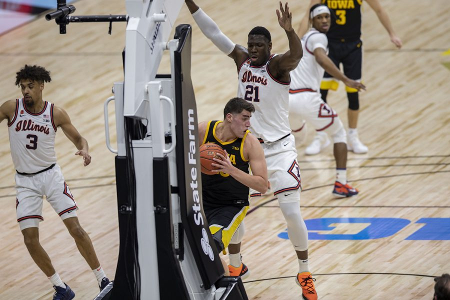 Iowa center Luka Garza looks to make a pass during the first half of the Big Ten men's basketball tournament semifinals against Illinois on Saturday, March 13, 2021 at Lucas Oil Stadium in Indianapolis. The Hawkeyes are behind the Fighting Illini, 37-45 at halftime. (Hannah Kinson/The Daily Iowan)
