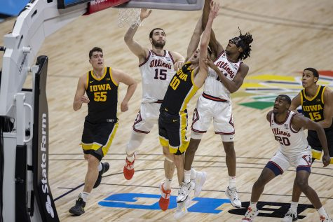 Iowa guard Joe Wieskamp reaches for a rebound during the first half of the Big Ten mens basketball tournament semifinals against Illinois on Saturday, March 13, 2021 at Lucas Oil Stadium in Indianapolis. The Hawkeyes are behind the Fighting Illini, 37-45 at halftime. (Hannah Kinson/The Daily Iowan)