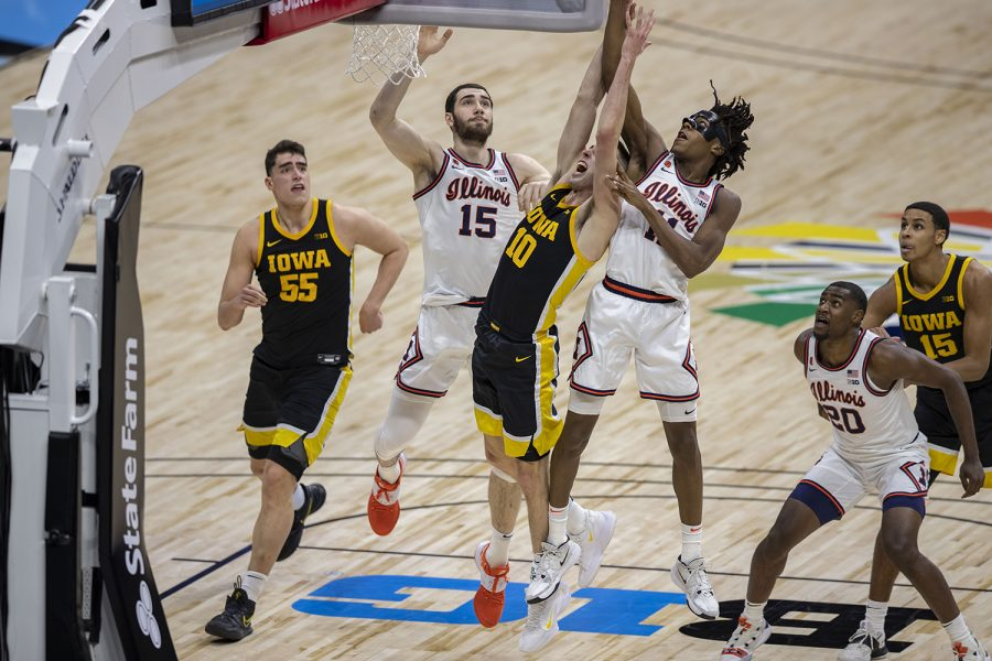 Iowa guard Joe Wieskamp reaches for a rebound during the first half of the Big Ten men's basketball tournament semifinals against Illinois on Saturday, March 13, 2021 at Lucas Oil Stadium in Indianapolis. The Hawkeyes are behind the Fighting Illini, 37-45 at halftime. (Hannah Kinson/The Daily Iowan)