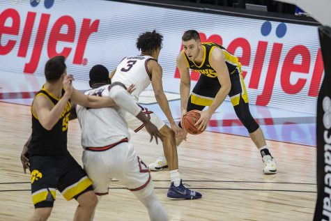 Iowa guard Connor McCaffery looks to pass the ball during the Big Ten men