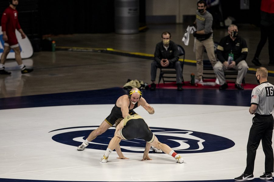 Iowa's Alex Marinelli looks for an opening to take a shot against Purdue's Gerrit Nijenhuis during the opening session of the Big Ten Wrestling Tournament at the Bryce Jordan Center in State College, PA on Saturday, March 6, 2021. Marinelli won the match by major decision. The Hawkeyes ended the first session with a team score of 75.5, putting them in first ahead of second place, Nebraska, with a score of 63.