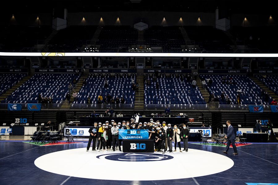 The Iowa Hawkeye wrestling team poses with the Big Ten Title trophy during the finals of the Big Ten Wrestling Tournament at the Bryce Jordan Center in State College, PA on Sunday, March 8, 2021. The Hawkeyes won the Big Ten Title with a team score of 159.5. This is the 37 Big Ten Title in school history.
