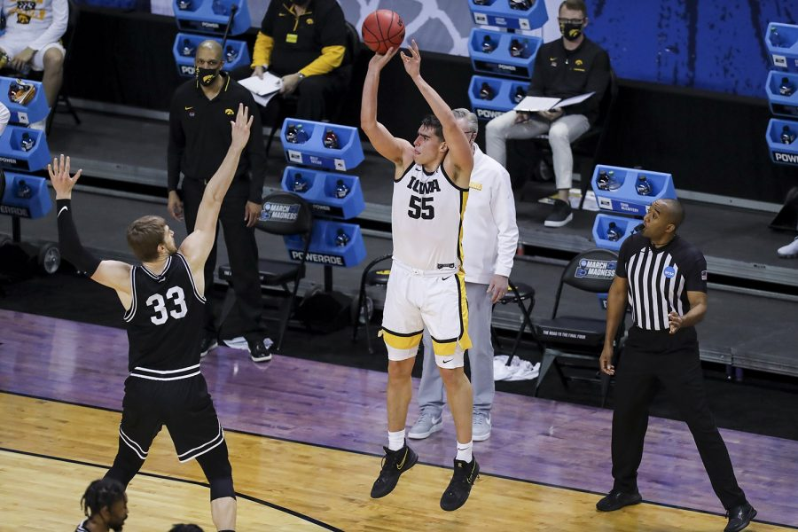 Mar+20%2C+2021%3B+Indianapolis%2C+IN%2C+USA%3B+Iowa+Hawkeyes+center+Luka+Garza+%2855%29+makes+a+three+point+shot+over+Grand+Canyon+Antelopes+center+Asbj%C3%B8rn+Midtgaard+%2833%29+during+the+first+round+of+the+2021+NCAA+Tournament+at+Indiana+Farmers+Coliseum.++