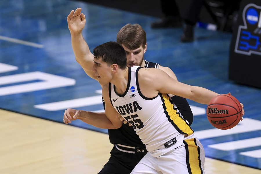 Mar 20, 2021; Indianapolis, IN, USA; Grand Canyon Antelopes center Asbjørn Midtgaard (33) defends against Iowa Hawkeyes center Luka Garza (55) during the first round of the 2021 NCAA Tournament at Indiana Farmers Coliseum.