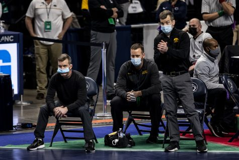 Iowa Head Coach Tom Brands and Associate Coach Terry Brands watch as Iowa's Austin DeSanto competes against Penn State's Roman Bravo-Young during the finals of the Big Ten Wrestling Tournament at the Bryce Jordan Center in State College, PA on Sunday, March 8, 2021. The Hawkeyes won the Big Ten Title with a team score of 159.5. This is the 37 Big Ten Title in school history.