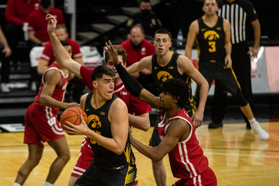 Iowa forward Luka Garza looks to pass during a men's basketball game between Iowa and Wisconsin at Carver-Hawkeye Arena on Sunday, March 7, 2021. The Hawkeyes, celebrating senior day, defeated the Badgers, 77-73. (Shivansh Ahuja/The Daily Iowan)